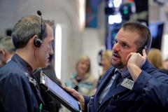 Wall St. slides as Saudi Arabia, Italy add to economic concerns