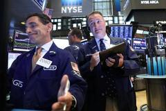 Earnings and trade optimism push Wall St. toward record high