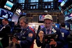 Wall Street posts modest gain as Fed signals rates to hold for some time