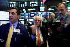 Wall St. falls after Fed signals another rate hike this year