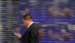 Asian stocks slip as U.S. rate risk sours sentiment, dollar holds...