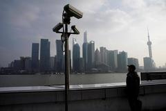 Asia business sentiment slips from seven-year high on trade...
