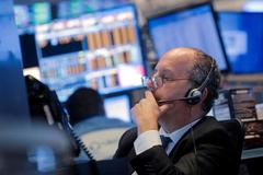 Wall Street ticks higher, but chip stocks tumble