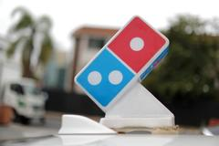 Domino's U.S. same-store sales, profit beat estimates, shares jump 20%
