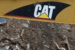 Caterpillar posts 46 percent rise in profit, boosts forecast