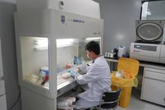 China biotech's 'coming out party' masks long road ahead