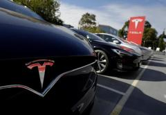 Tesla to cut production hours for Model S and X