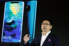 China's Huawei eyes smartphone supremacy this year after record...