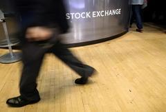 Wall St. rises on Microsoft's beat, rate cut euphoria