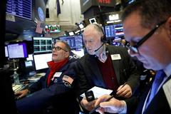 Global stocks, dollar slip as reports kindle trade deal hopes