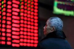 Asian shares climb on dovish Fed, but Brexit hurdle looms