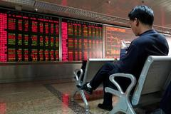 Stocks hold steady but virus anxiety lingers as millions travel for Lunar New Year break