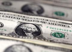U.S. dollar rises, but off highs, as Fed measures weigh