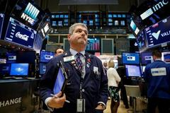 Wall Street higher on optimism over tax bill, Fed's economic outlook