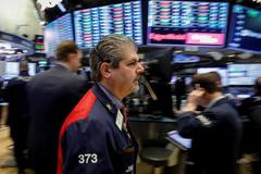 Wall Street ends higher despite government shutdown threat