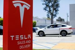 At T. Rowe Price, top Tesla funds offer split views