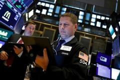 Wall Street mixed as Microsoft climbs and Apple dips