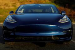 Tesla shares soar 21% as surprise profit answers skeptics