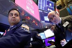 Global stocks rise after Fed keeps rates on hold; oil falls